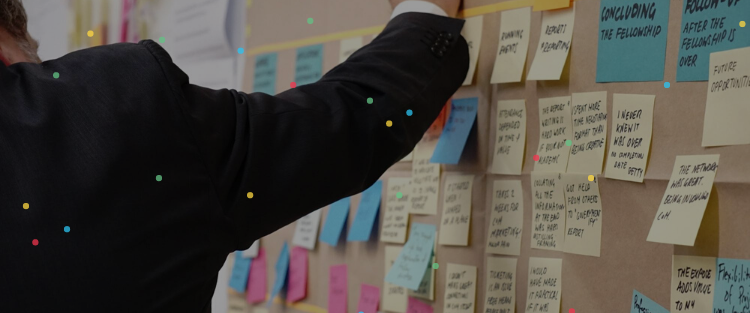Man putting sticky notes on the wall