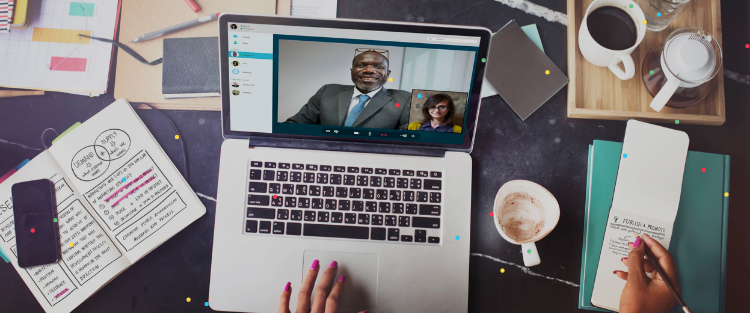Laptop showing a virtual meeting with two attendees